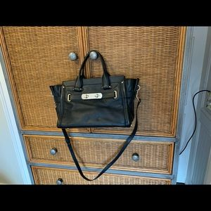 Black used leather coach bag. Very clean like new.